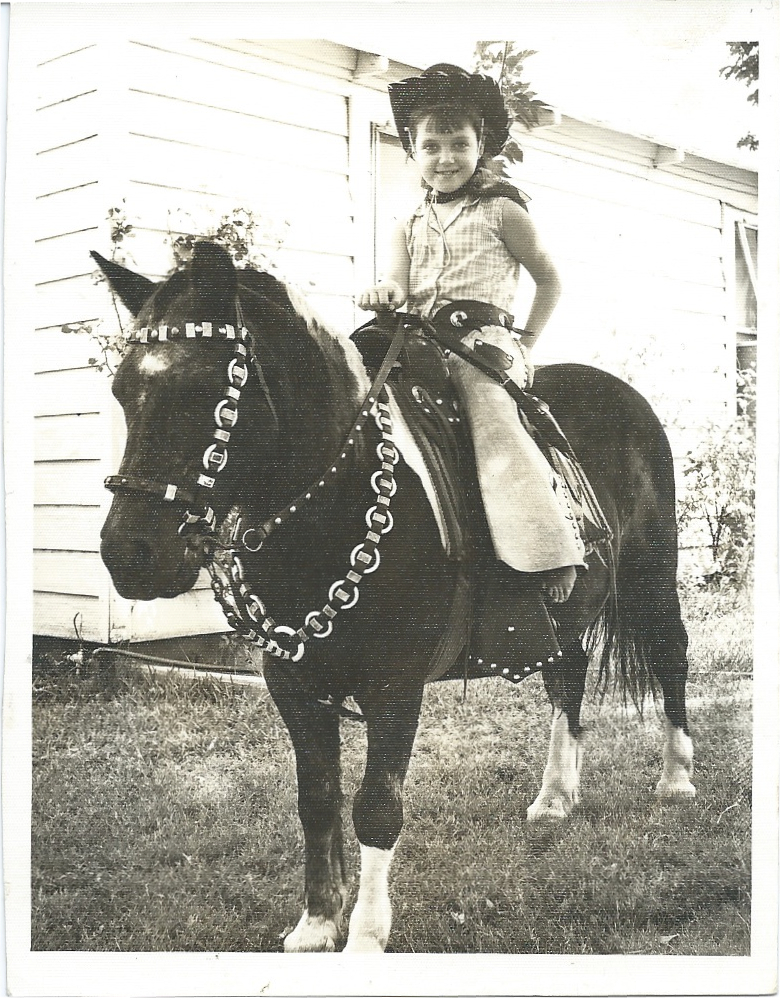 Kimmie Rhodes as a child on a horse